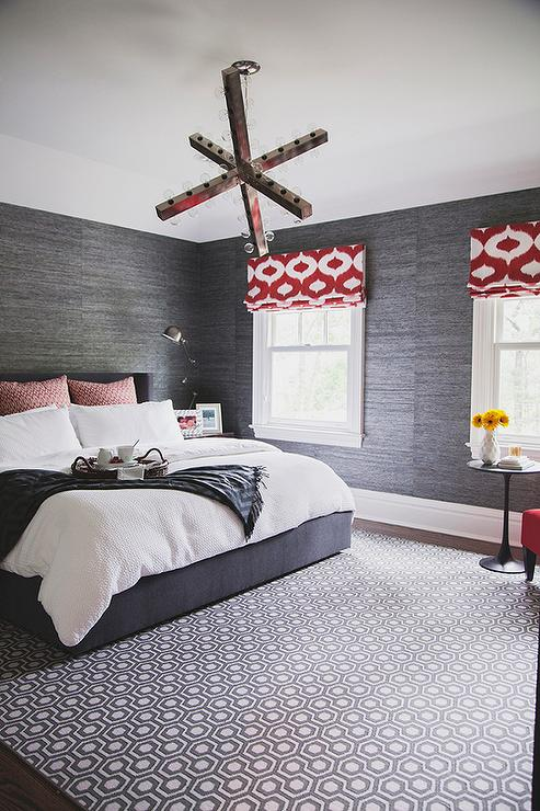 Charcoal Gray Bedroom With Red Accents Features Walls Clad In Charcoal Gray  Grasscloth Lined With A Dark Gray Bed Dressed In Soft White Bedding, ...