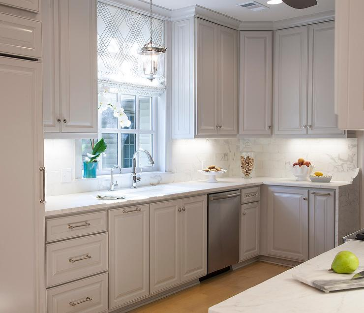 View Full Size Beautiful Kitchen Features Light Gray Cabinets With Raised Panel Doors Paired With Honed White