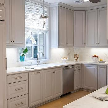 Pale Gray Kitchen Cabinets With Honed White Marble Countertops