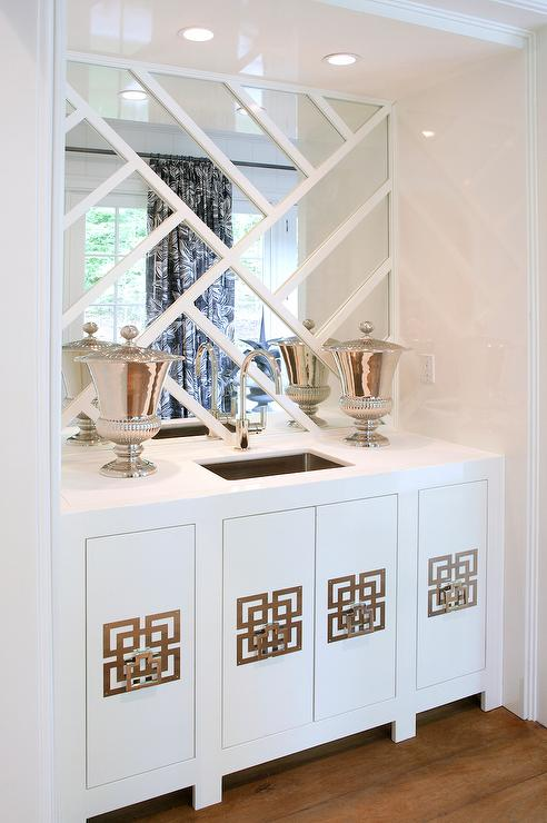 Amazing Living Room Wet Bar Nook Is Filled With White Lacquer Cabinets Accented Geometric Hardware Alongside A Stainless Steel Sink And Gooseneck