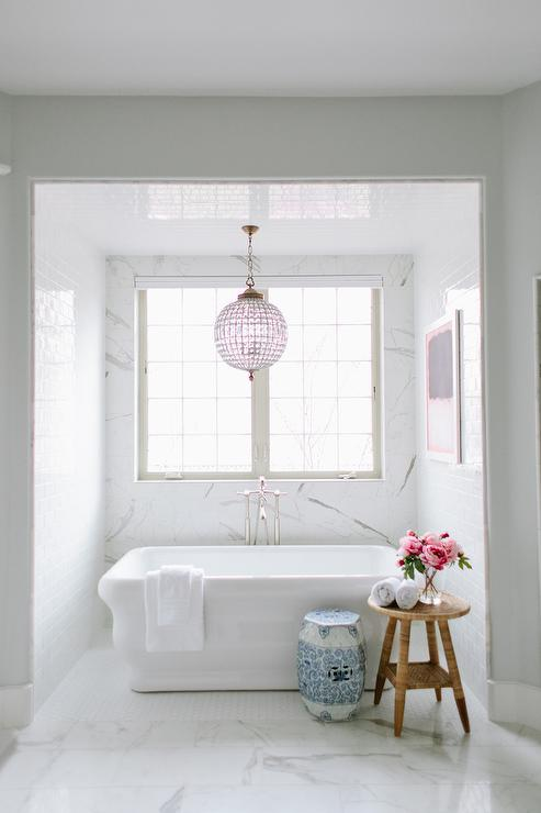 crystal chandelier over corner tub with marble saarinen side table, Lighting ideas