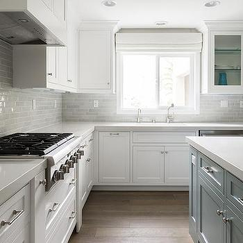 paired with white quartz countertop and a gray brick tiled backsplash
