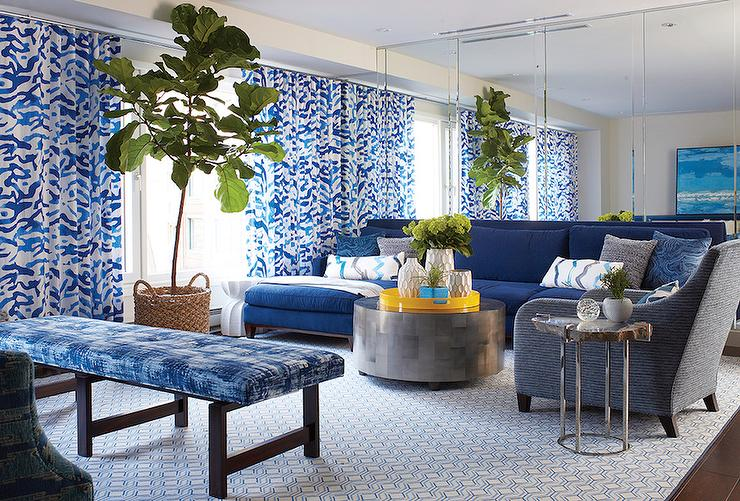 blue living room with mirrored accent wall - contemporary - living room