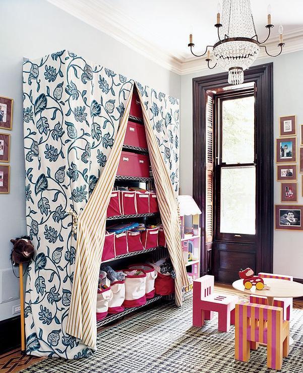 Industrial Playroom Shelves Hidden Behind Curtains