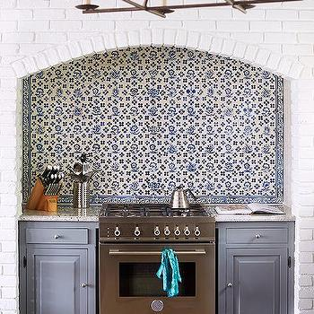 Arched Cooking Alcove With Blue Mosaic Tiles