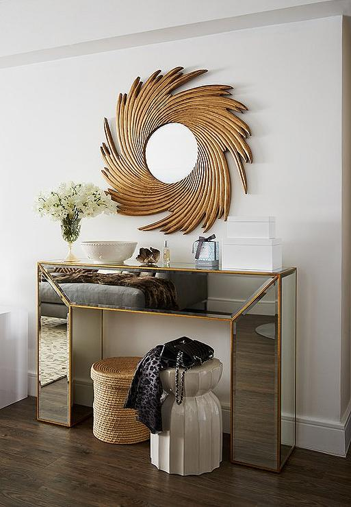 gold mirrored console table with gold sunburst mirror