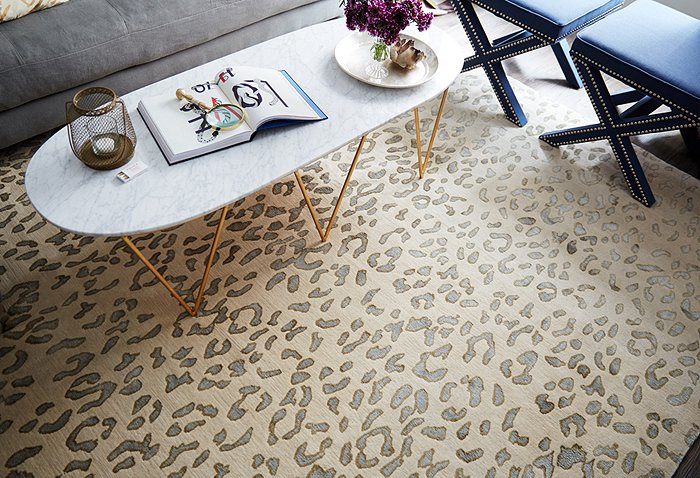 animal print rugs for living room oval brass marble coffee table navy velvet stools rug leopard wool sale
