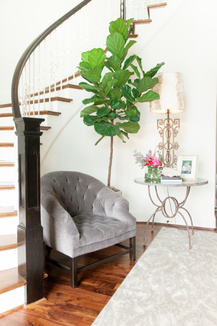 Foyer Accent Chair : Curved staircase nook with chair and table transitional