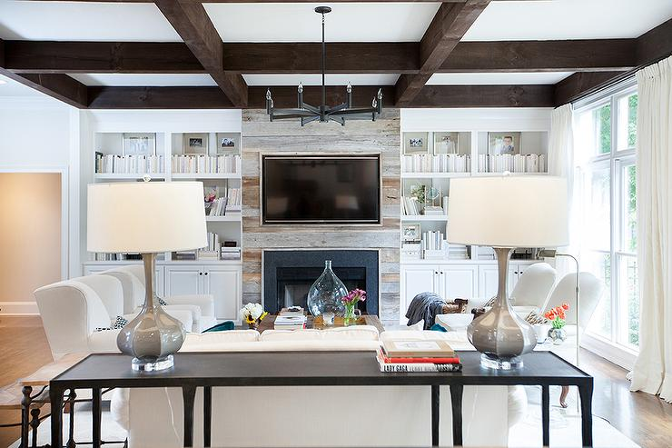 Plank Fireplace Flanked By White Built In Bookcases