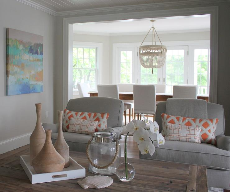 living room pillows. Gray Chairs with Orange Pillows  Transitional Living Room