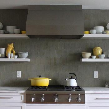 White floating stove shelves with black sconces for Gray and yellow kitchen ideas
