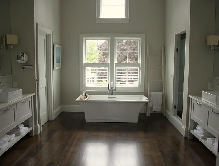 Tub Under Windows Dressed In Plantation Shutters
