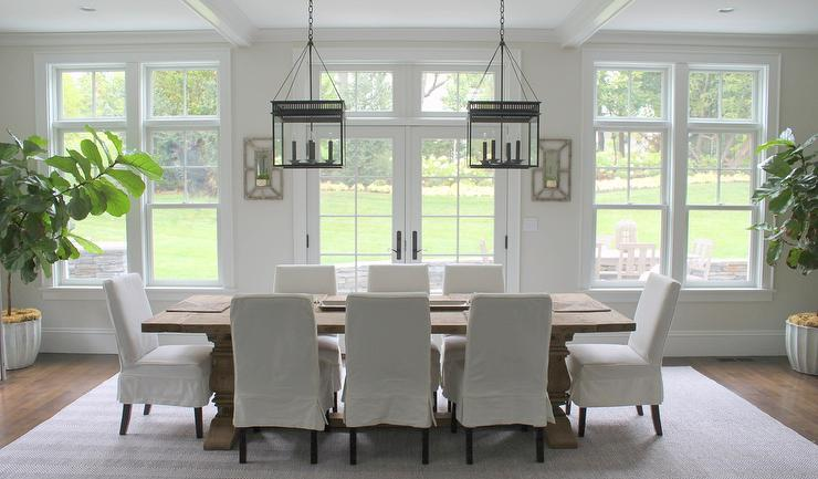 Transitional Dining Room Features A Pair Of The Urban Electric Co Chisholm Lanterns Illuminating Restoration Hardware Salvaged Wood Trestle Rectangular