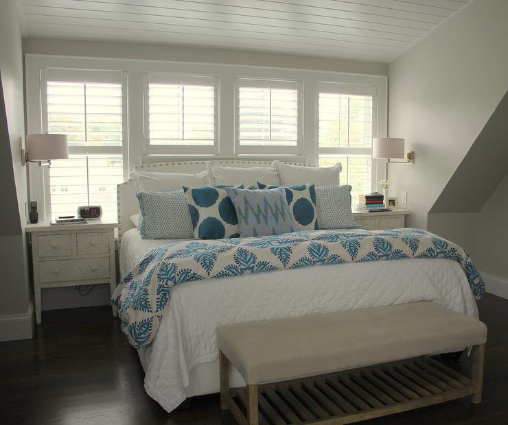 Charming Sweet Bedroom Features A White Nailhead Headboard On King Bed Dressed In  White And Blue Bedding And Blue Ikat Pillows Along With A Bench With A  Slatted ...