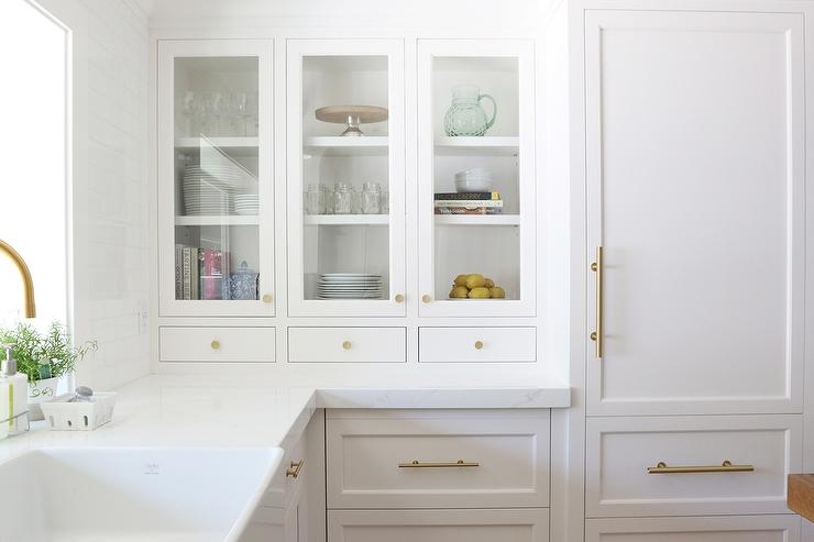 White Paneled Refrigerator With Brass Handle