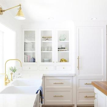 White paneled refrigerator with brass handle for Benjamin moore chantilly lace kitchen cabinets