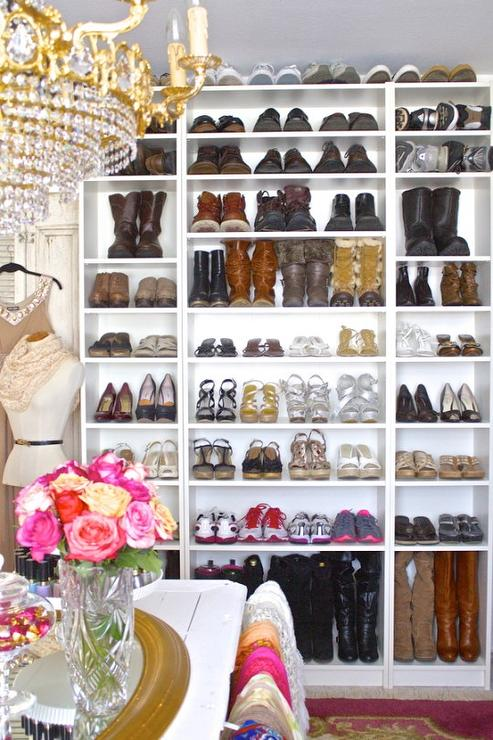 Fantastic Walk In Closet Boasts A Freestanding Shelving Unit Filled With  Shoes And Boot Situated Across From A Closet Island Illuminated By A Paris  Flea ...