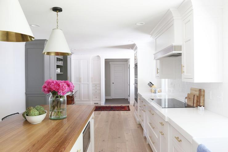 White Kitchen Cabinets with Long Brass Pulls - Transitional ...