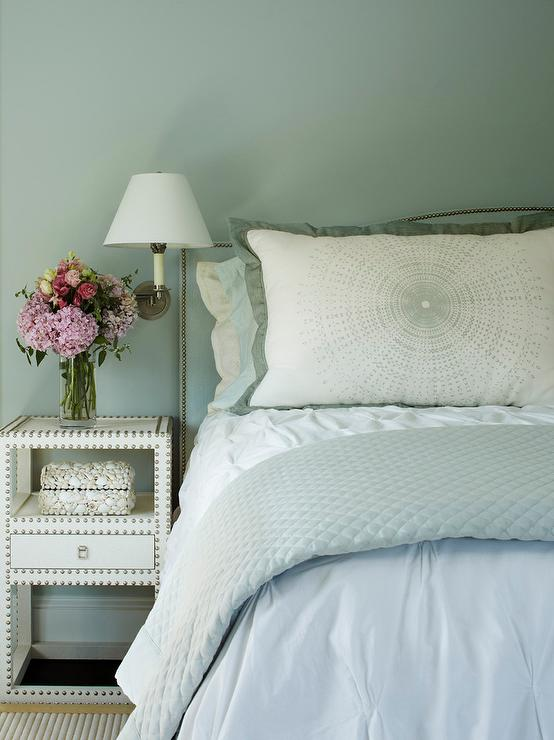 Serene Bedroom Features A Blue Wall Lined With A Blue Curved Headboard With  Silver Nailhead Trim On Bed Dressed In White And Blue Bedding Next To A  White ...