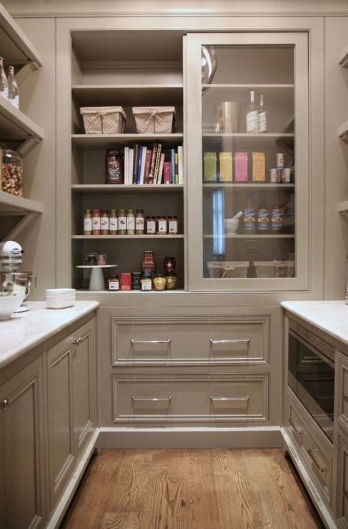 Grey pantry cabinets with sliding doors transitional for Kitchen door design