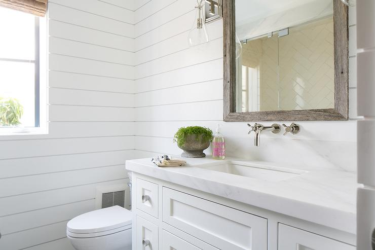 Transitional Bathroom Wall Sconces guest bathroom with shiplap - transitional - bathroom