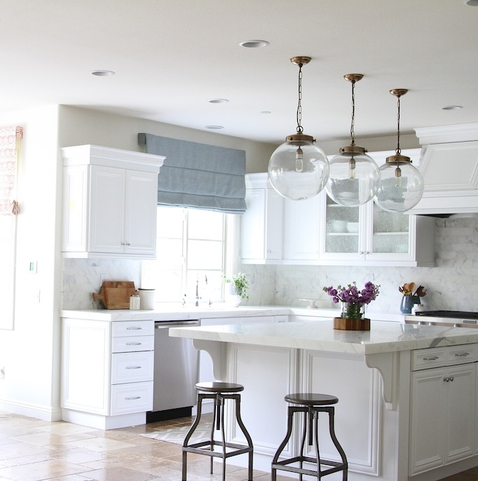 White Kitchen With Regina Andrew Large Globe Pendants And