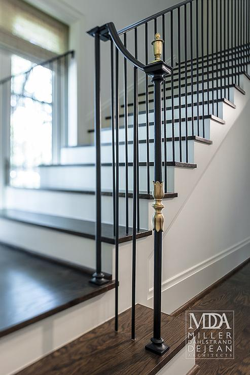 Black Staircase With Gold Finials