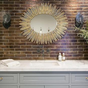 Gray and gold wallpaper with sunburst mirror for Prescott mirror