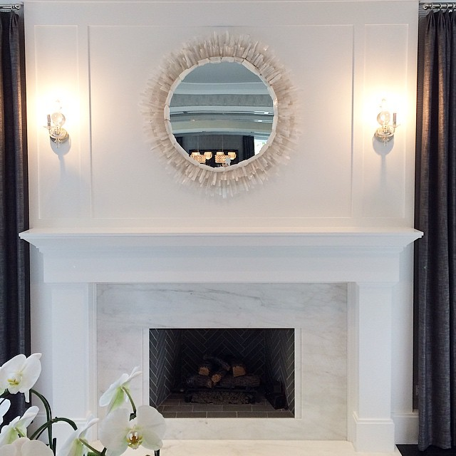 White Marble Fireplace Surround With A Gray Herringbone Firebox Transitiona