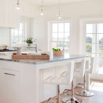 White Kitchen Island With Super White Quartzite Countertops