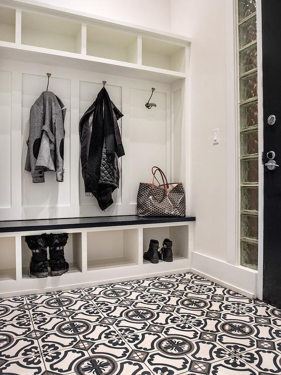 Mudroom with a gray abd black mosaic tiled floor Mudroom floor