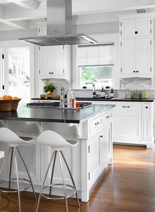 White kitchen island with soapstone countertops transitional kitchen Kitchen design center stove