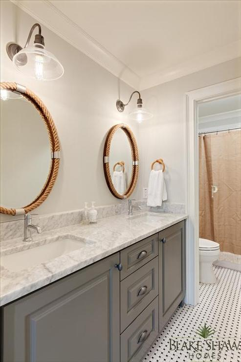 Delightful Lovely Bathroom Features A Gray Dual Washstand Topped With Carrera Marble  Fitted With His And Her Sinks And Modern Faucets Placed Under Individual  Oval Rope ...
