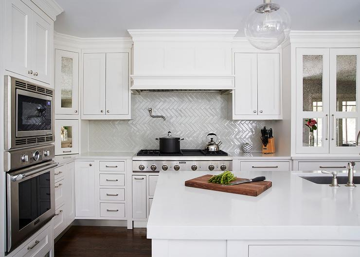 White and gray kitchen cabinets with antiqued mirrored for Atrium white kitchen cabinets