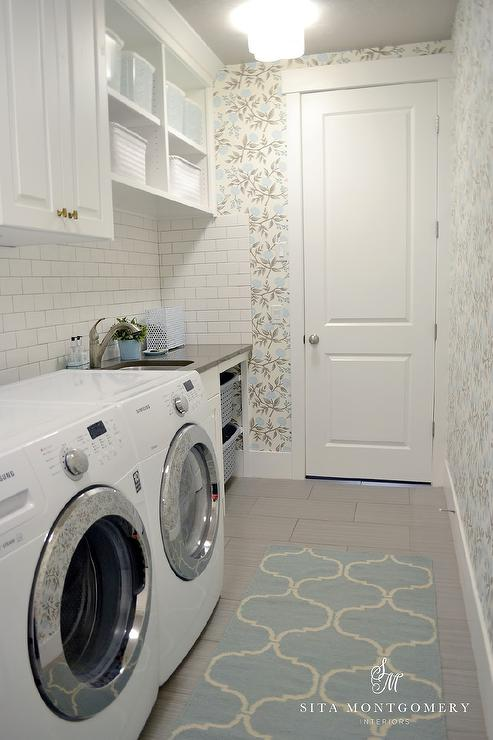 Blue and gray laundry room features walls clad in blue and grey floral wallpaper lined with a - Laundry basket ideas for small space ideas ...