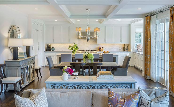 Open Floor Plan Features A Coffered Ceiling Accented With Vivian One Tier Chandelier Illuminating Dark Stained Rectangular Dining Table Lined Wood