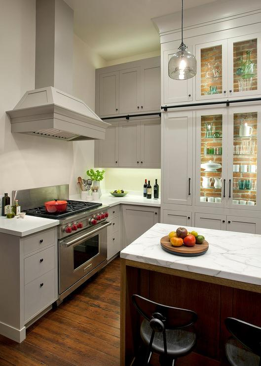 lit kitchen cabinets with glass shelves transitional