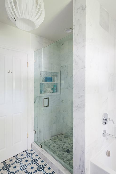 Beautiful Master Bath Features A Seamless Glass Shower Clad In White Marble  Tiles Fitted With A Niche Alongside A Blue And Gray River Rock Shower Floor. Part 69
