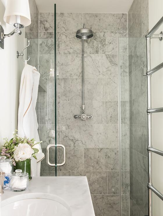 Fabulous Bathroom Features A Walk In Shower Clad In Grey Marble Tiles Lined  With A Vintage Exposed Plumbing Shower Head Finished With A Seamless Glass  Door.