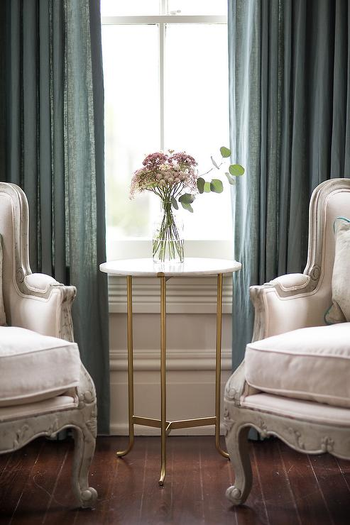 bay window furniture living. Chic Living Room Features A Bay Window Dressed In Blue Curtains Filled With Pair Of French Chairs And Round Brass Marble Table. Furniture