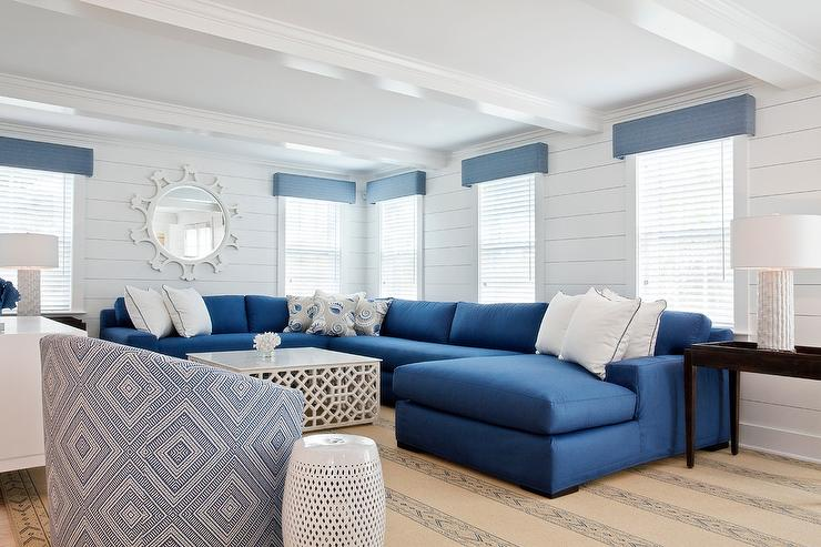 blue sectional with white coffee table cottage living room