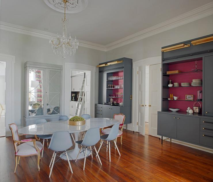 Contemporary Dining Room Features A Pair Of Matching Gray Shelving Units With Backs Shelves Painted Hot Pink Stacked Over Cabinets Gold Knobs