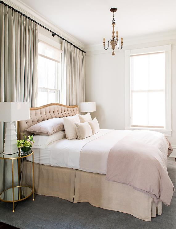 Gray Tufted Bed With Round Whitewashed Nightstands With