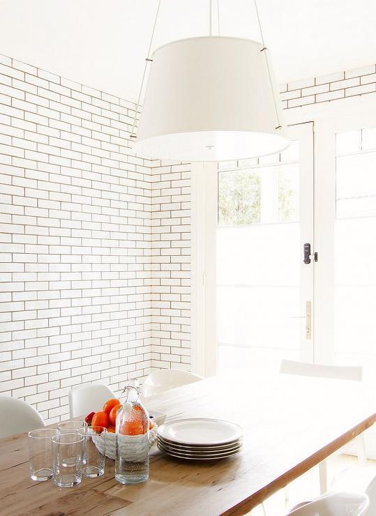 Subway Tiled Dining Room Walls - Transitional - Dining Room