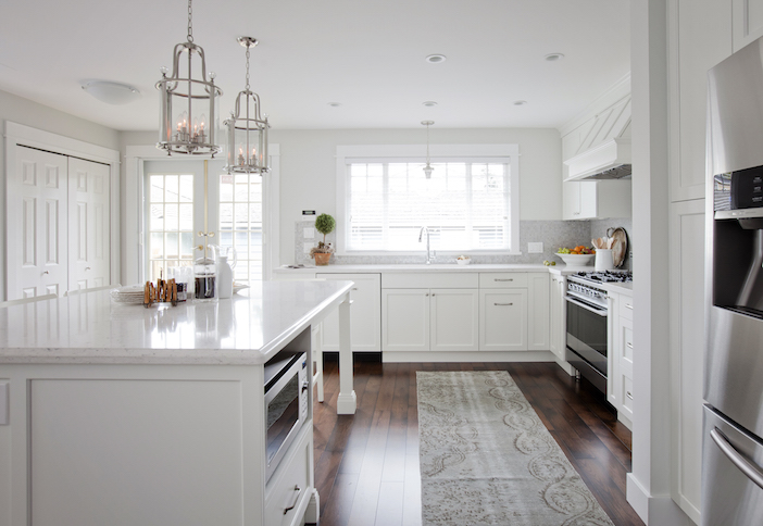 Stunning Kitchen Features A Pair Of Hudson Valley Lighting Mansfield  Lanterns Illuminating A White Center Island With Legs Topped With Silestone  Bianco ...
