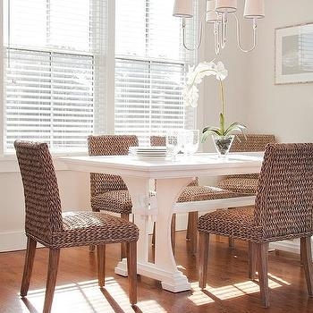 White Trestle Dining Table With Wicker Dining Chairs