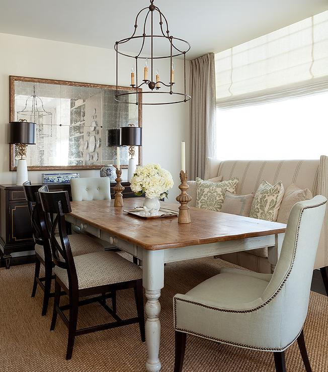 View Full Size Beautiful Dining Room Features An Iron Cage Chandelier Illuminating A Whitewashed Farmhouse Table Lined