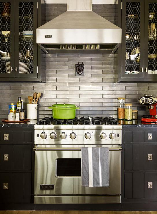 Black Cabinets with Stainless Steel Backsplash