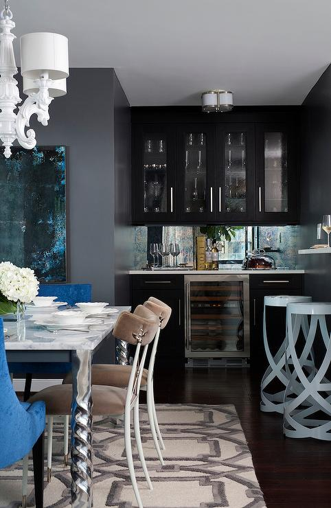 Contemporary Dining Room Features A Nook Filled With Glass Front Upper Cabinets And Black Lower Paired White Quartz Countertop Blue