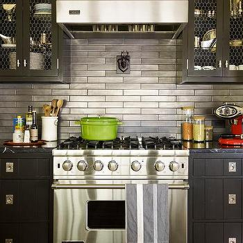 thom filicia black cabinets with stainless steel backsplash